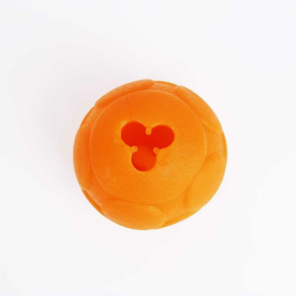 large orange ball with hole