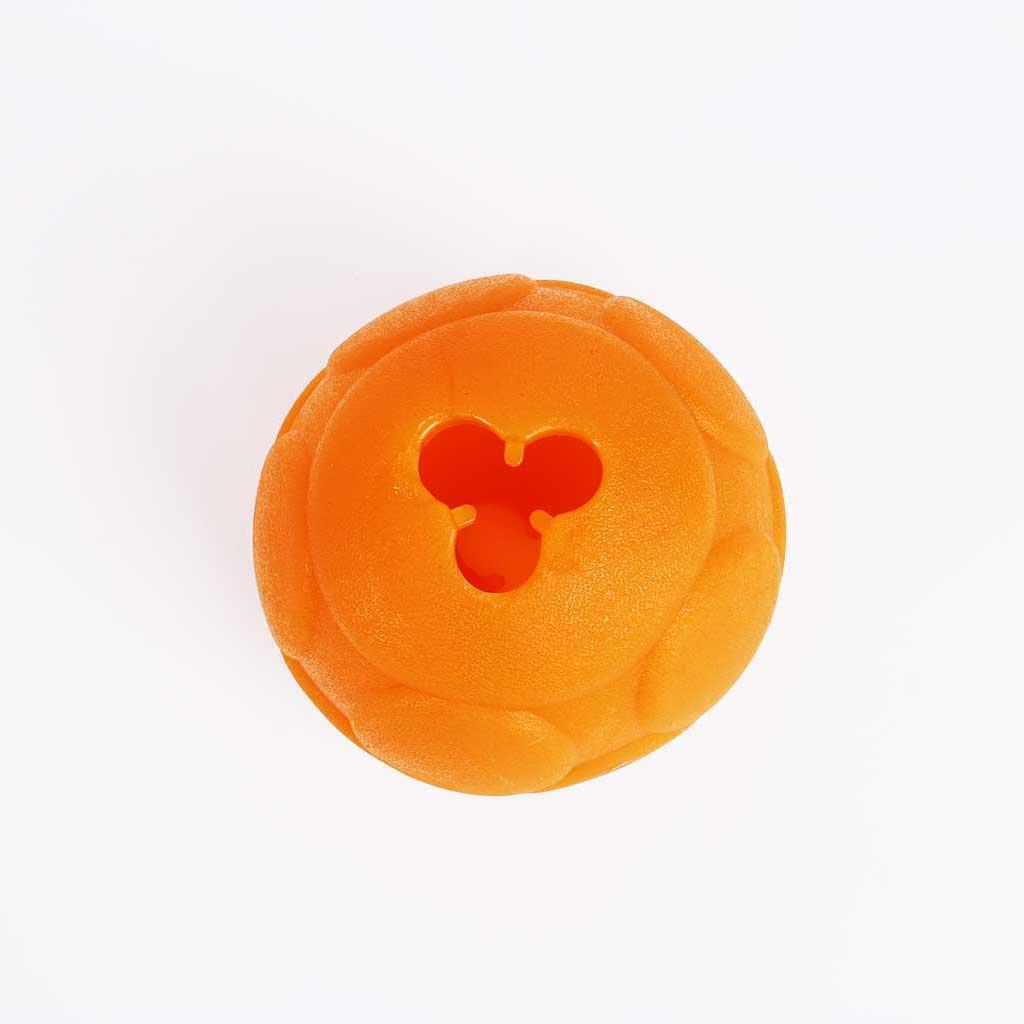 large orange ball with hole