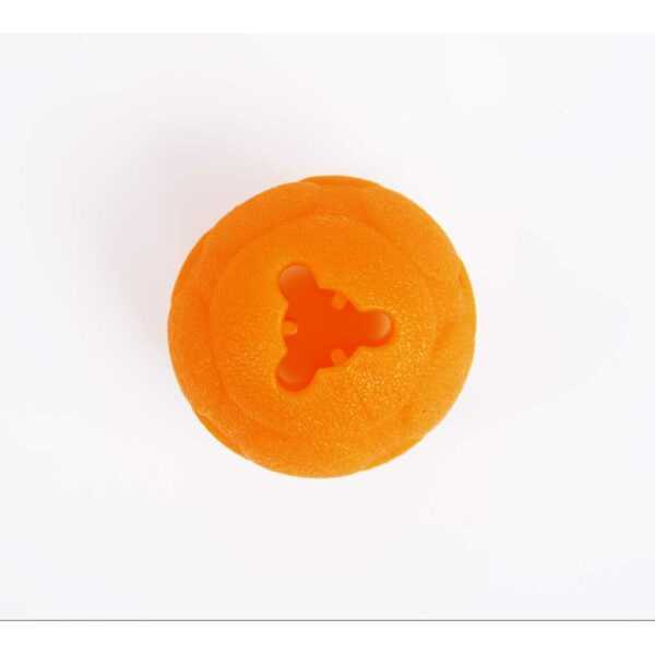 small orange ball with hole